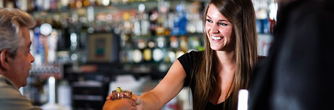 Bartender serves a customer